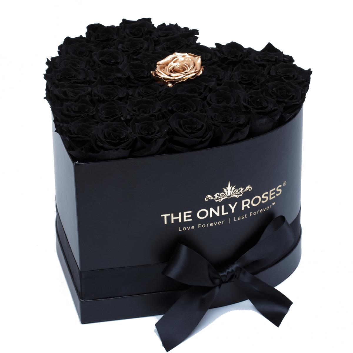 Композиция 100 Черни и една златна Полиуретанови Рози в кутия с форма на сърце