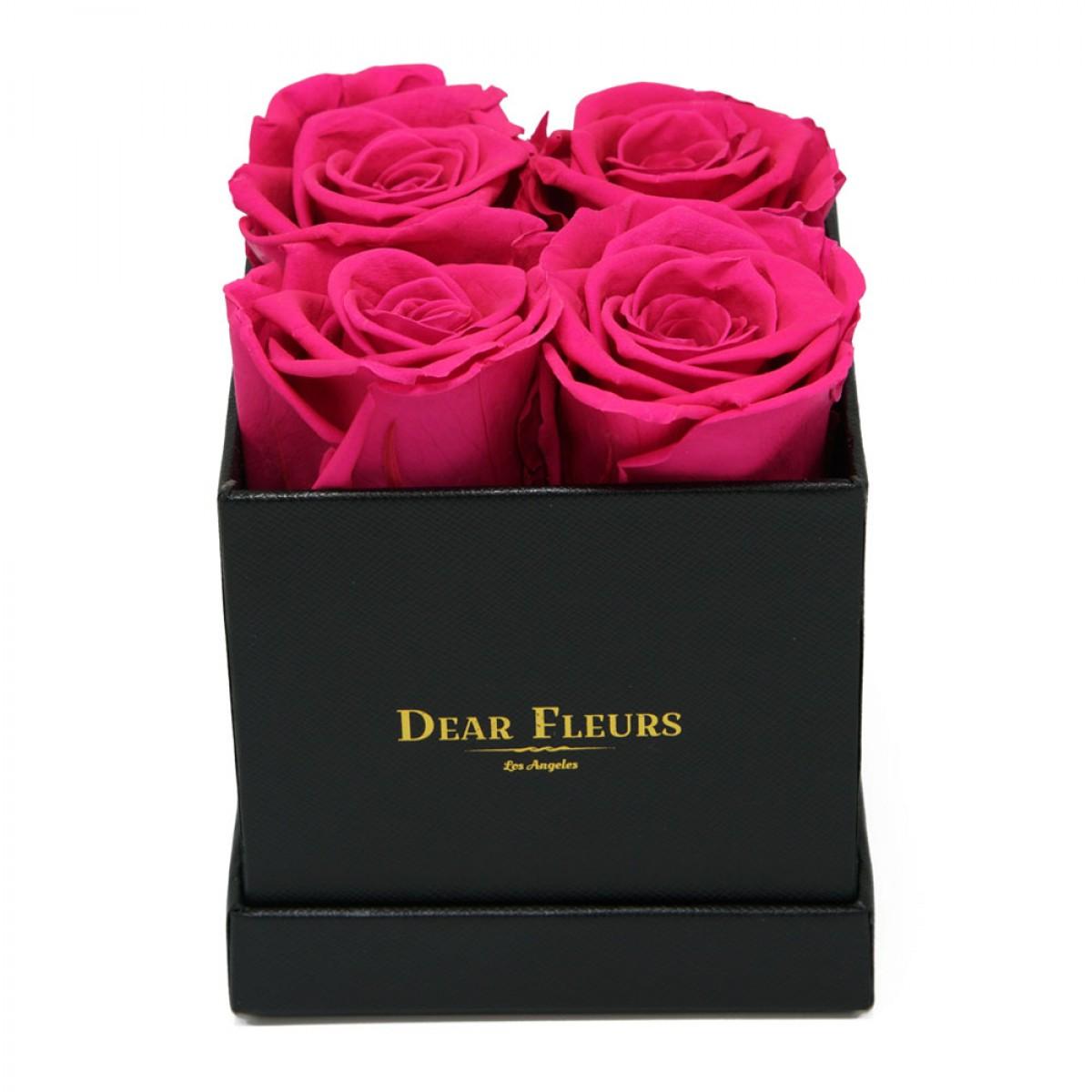 4 или 5 розови рози в стилна черна кутия