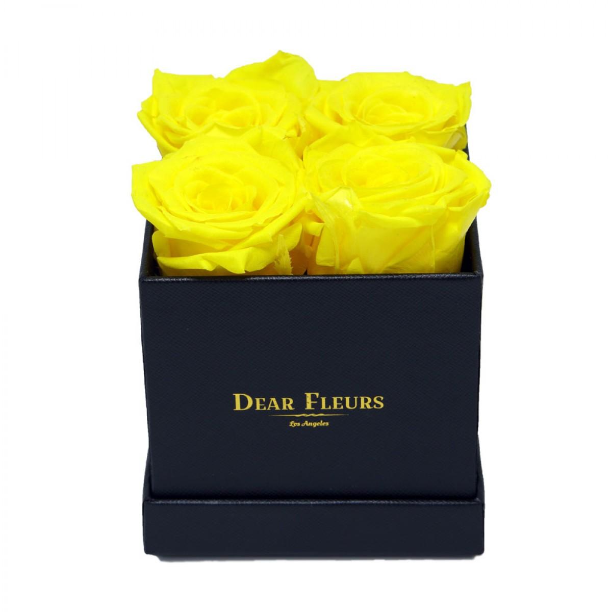 4 или 5 жълти рози в стилна черна кутия